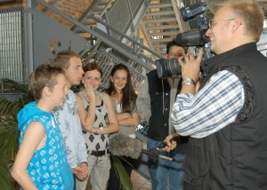 A group of young actors being interviewed at the Atching Tan Launch event